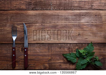 Fork And Knife On Wooden Vintage Table