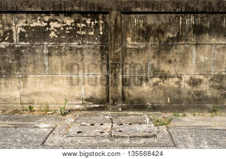 old wall with cracks background and grass