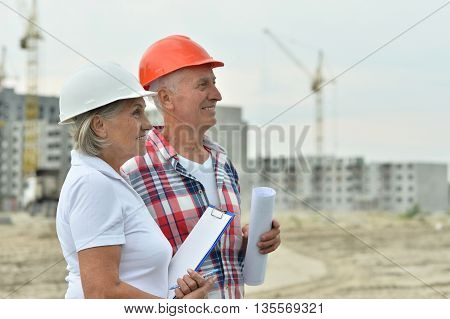 Portrait of senior couple in under construction