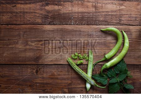 Fresh Green Chillies On Wooden Chopping Board.