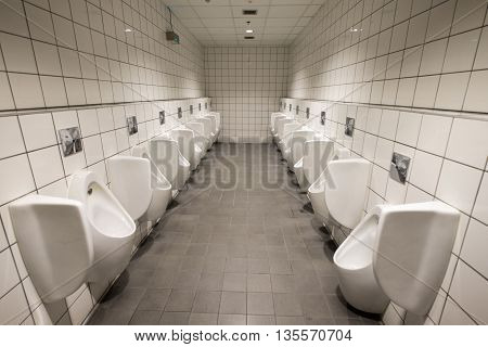 Row of lavatory for male in the restroom.
