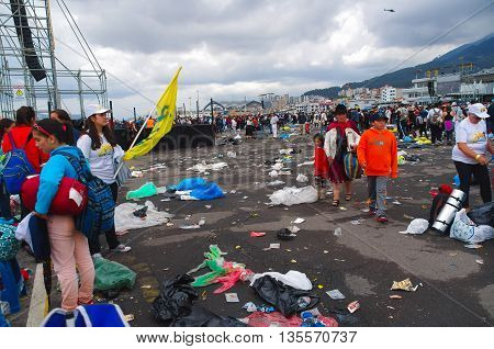 QUITO, ECUADOR - JULY 7, 2015: Huge event in quito, pope Francisco mass. Lots of garbage on the floor.