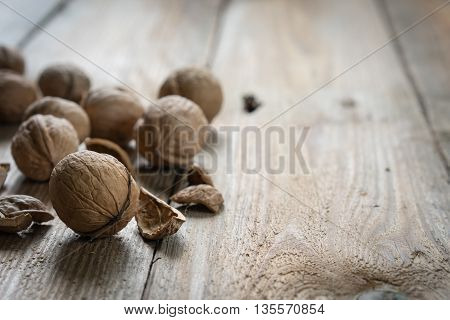 Walnuts on a wooden table side view.