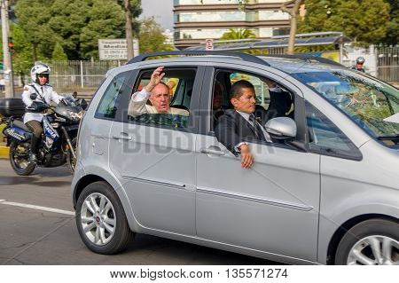 QUITO, ECUADOR - JULY 7, 2015: Body guards and police with pope Francisco, saying hello to people in Ecuador.