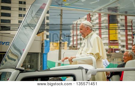 QUITO, ECUADOR - JULY 7, 2015: Pope Francisco around Quito streets in his popemobile, stand up.