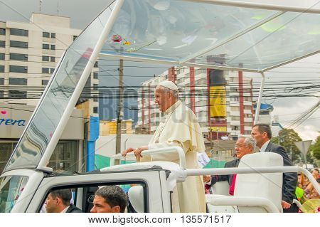 QUITO, ECUADOR - JULY 7, 2015: Pope Francisco saying hello to Ecuadorian people on Quitos street, stand up in his popemobile.