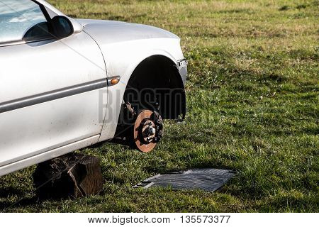 Changing the car tyre in the garden