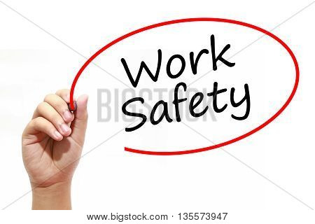 Man Hand writing Work Safety with marker on transparent wipe board. Business internet technology concept.