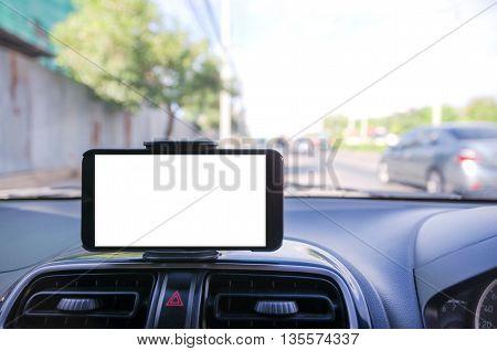 Mobile smart phone using for GPS navigator selective focus shallow depth of fileld road bacground