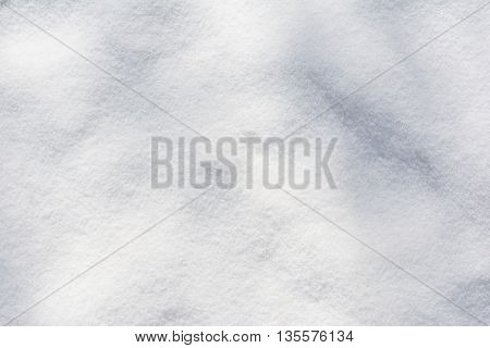 texture of a white fresh snow at afternoon