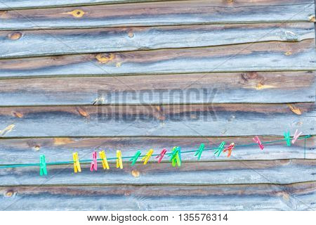 Colorful Clips Hanging On Washing Line
