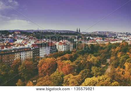 View to the Vysegrad in Prague, Czech Republic at autumn with cathedral and red roofs, travel seasonal vintage hipster background
