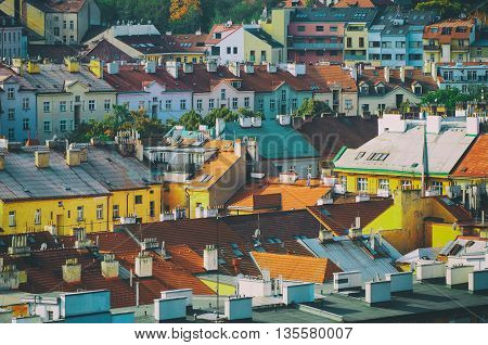 View to the colorful roofs and houses of Vysegrad in Prague, Czech Republic at autumn - aerial image, travel seasonal vintage hipster background