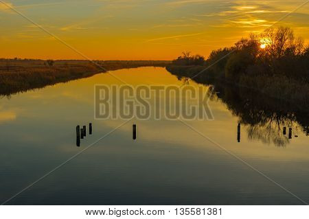 Landscape with sunset over small Ukrainian river Orel
