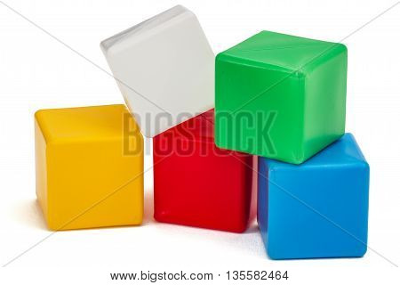 Bright colored childrens cubes isolated on white background