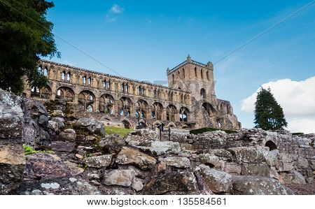 Upward view of the ruins of Jedburgh Abbey in the Scottisch Borders region in Scotland