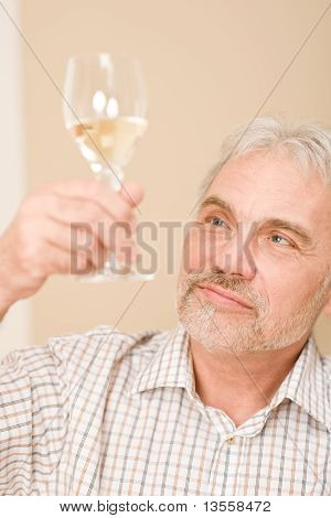 Senior Mature Man With Glass Of White Wine