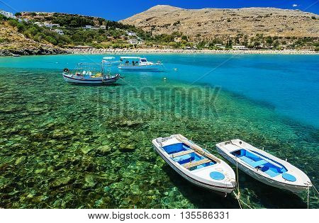 view of coast with boats in Lindos bay, Greece