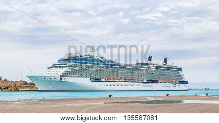 big white cruise ship in port of the island of Rhodes Greece