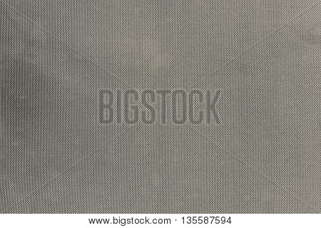 grained or speckled texture of beige color for abstract tone or for wallpaper