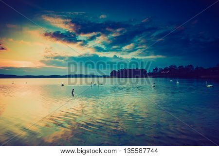 Vintage Photo Of Sunset Over Calm Lake