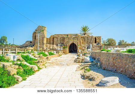 The preserved medieval Crusader Gate at the entrance to Caesarea archaeological site Israel.
