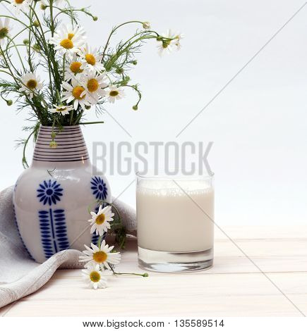 glass of cold milk on the wooden table