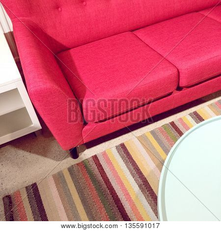 Bright pink sofa and coffee table. Modern style furniture.