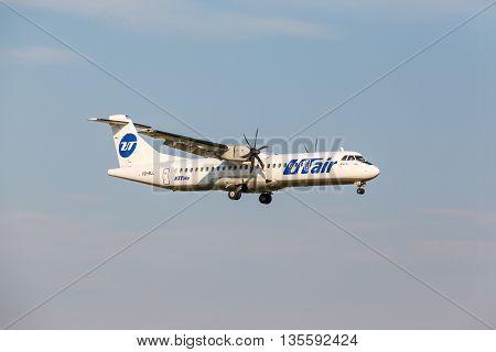 VNUKOVO, MOSCOW REGION, RUSSIA - 28 August, 2013: Airplanes at Vnukovo international airport. Utair Airlines Atr 72 landing to runway
