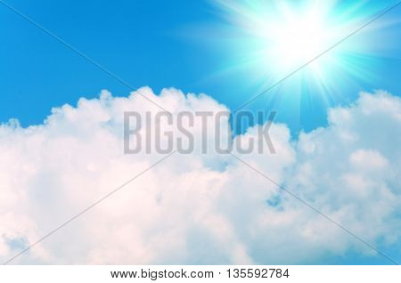 Abstract background of blue sky and white clouds with the sun shining
