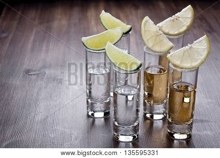 Shots of tequila on a wooden table