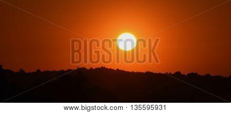 Orange sunset on path near village Tisa