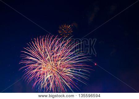 Fireworks Of Various Colors Bursting Against A Black