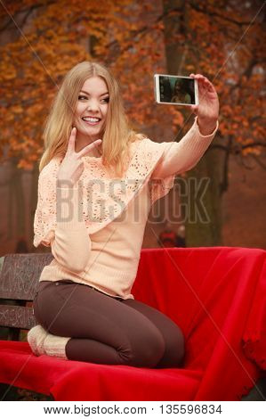 Blonde Young Girl Taking A Selfie.