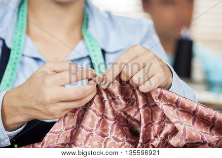Female Tailor Stitching Textile In Sewing Factory