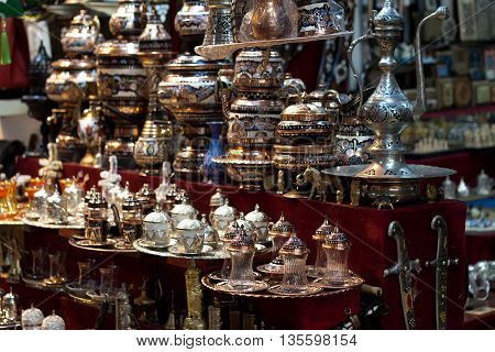 Brass tea sets and serving platters in the Grand Bazaar Kapali carsi in Istanbul, Turkey