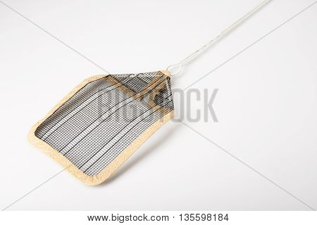 A household flyswatter on white with shadow.
