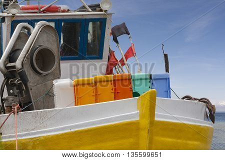 Winch and boxes on a fishing boat standing in port