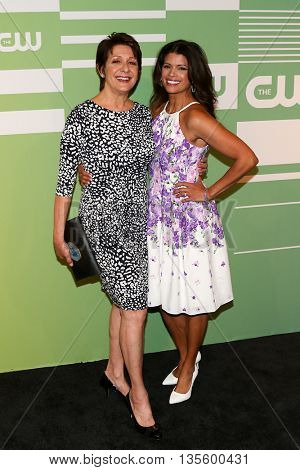 NEW YORK, NY - MAY 14: Actors Ivonne Coll (L) and Andrea Navedo attend the 2015 CW Network Upfront Presentation at the London Hotel on May 14, 2015 in New York City.