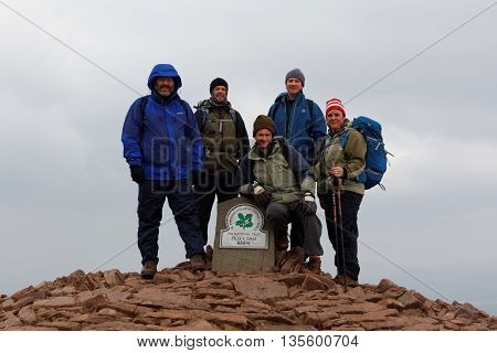 BRECON BEACONS, WALES, 27 FEB 2016.  Editorial Photograph of Hikers at Summit of Pen y Fan, Brecon Beacons National Park, South Wales