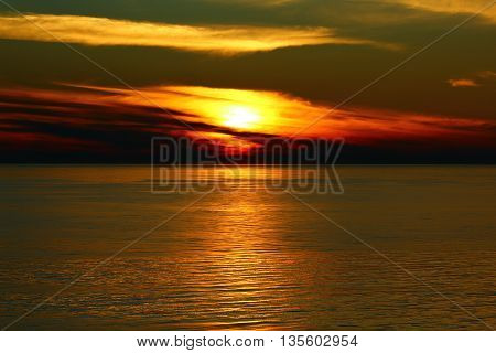 The sunset in the evening at the Baltic sea