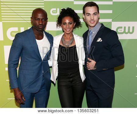 NEW YORK, NY - MAY 14: (L-R) Actors David Gyasi, Christina Moses and Chris Wood attend the 2015 CW Network Upfront Presentation at the London Hotel on May 14, 2015 in New York City.