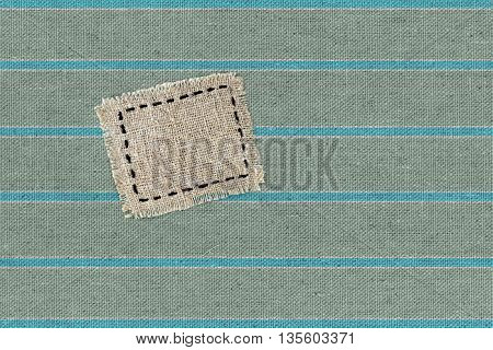 fabric texture background with sackcloth label patch