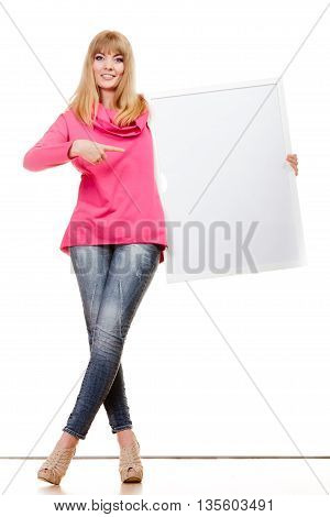 Advertisement concept. Fashion woman full body with blank presentation board. Female model pointing banner sign billboard copy space for text. Isolated