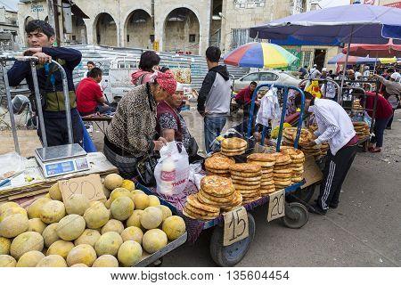 BISHKEK, KYRGYZSTAN - MAY 27, 2016: People shop in the Osh Bazaar, in Bishkek, Kyrgyzstan.