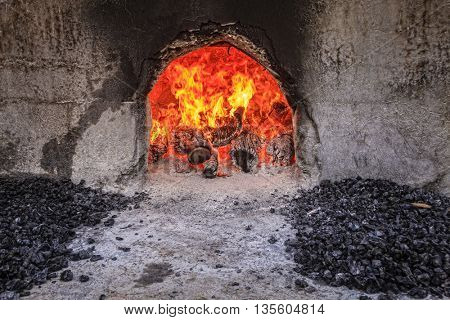 Wood fired ovens at a halwa factory in Nizwa, Oman