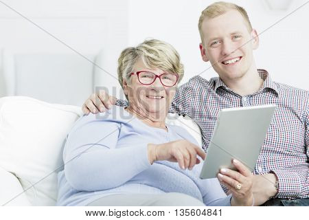Modern Grandmother Using Tablet