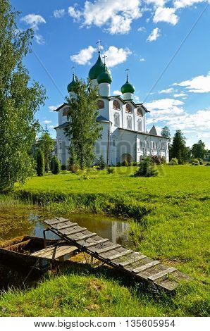 Architecture landscape - St Nicholas cathedral with pond in Nicholas Vyazhischsky stauropegic monastery Veliky Novgorod Russia architecture view in summer day Orthodox temple architecture