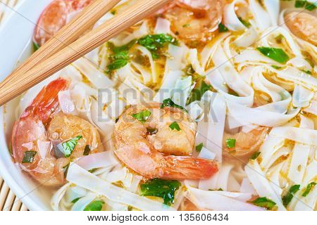 Seafood noodle soup in a white bowl