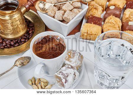 Traditional Turkish black coffee and sweet dainties